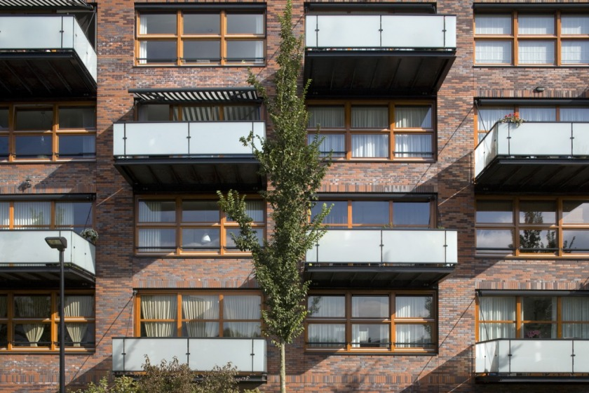 apartment building architect architecture brick balcony