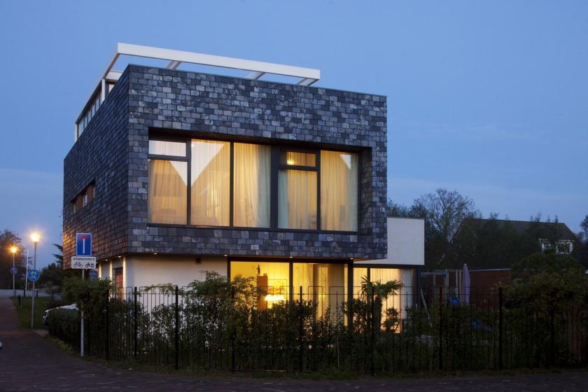 villa den haag ypenburg leisteen biesvaren dakterras moderne architectuur