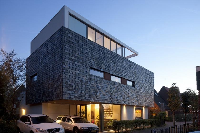 Villa woonhuis leisteen stucwerk aluminium ramen dakterras garage overstekHOYT architecten